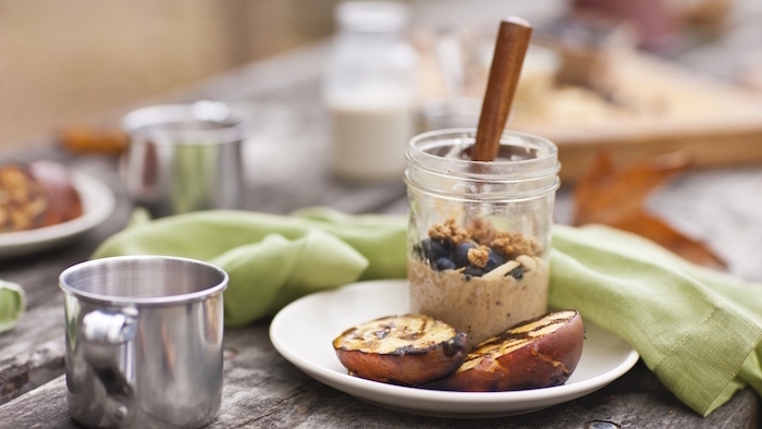 baked pears, granola and yoghurt, healthy meal prep ideas for the week, in mason jars, white plate
