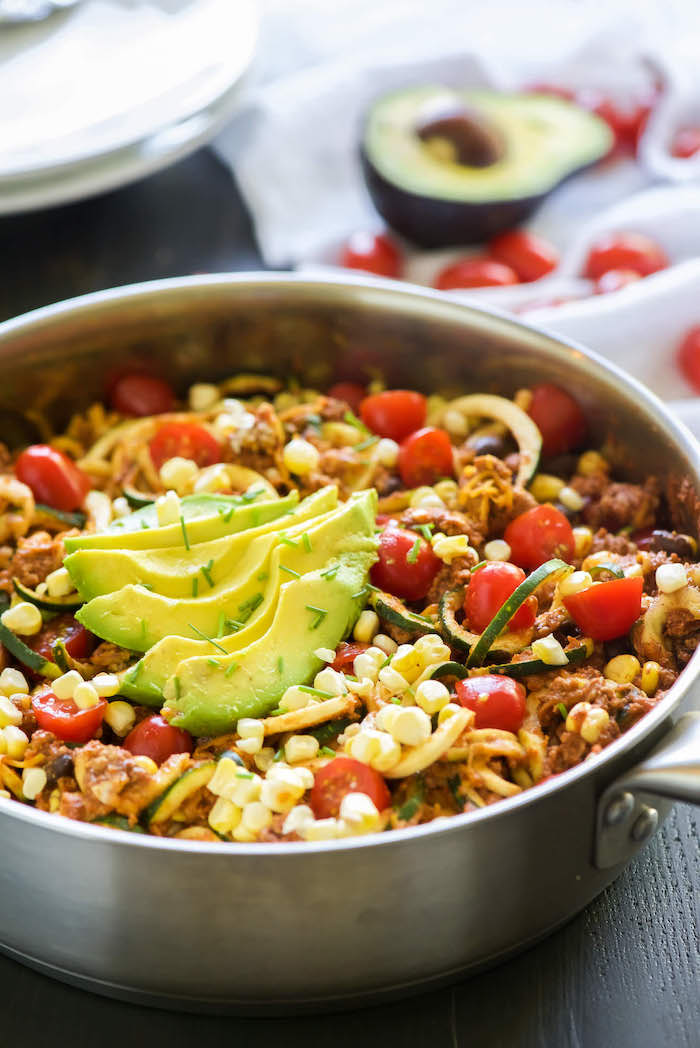 avocado slices, how to make zucchini noodles, cherry tomatoes, black beans, taco zoodles, in a skillet