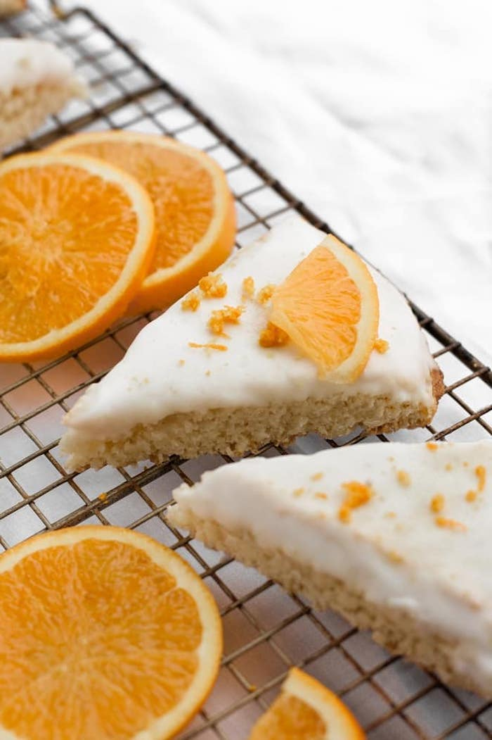 orange scones, white frosting, orange slices, orange flakes on top, keto breakfast recipes, arranged on metal rail