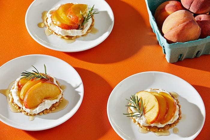 oatmeal bars, peach slices on top, on a white plate, summer dessert recipes, orange table