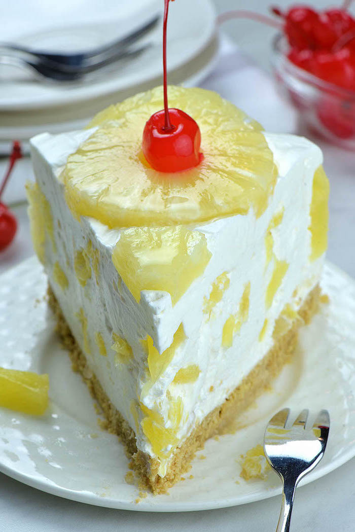 mothers day desserts, pineapple cheesecake, pineapple slice, cherry on top, white plate