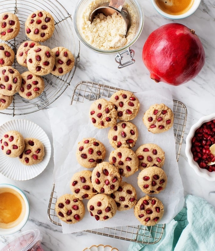 cookies with pomegranate seeds, chocolate chunk cookies, arranged on metal rail, white baking paper
