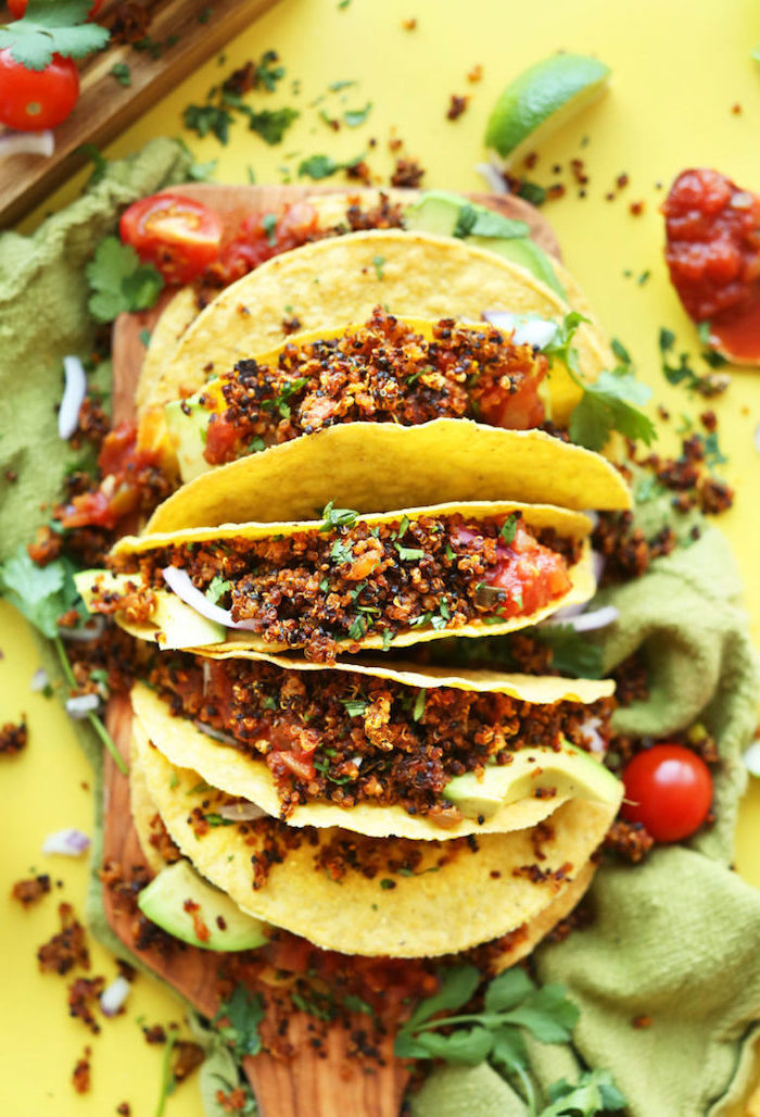green table cloth, taco ingredients, tortilla wraps, filed with quinoa, salsa sauce, cherry tomatoes