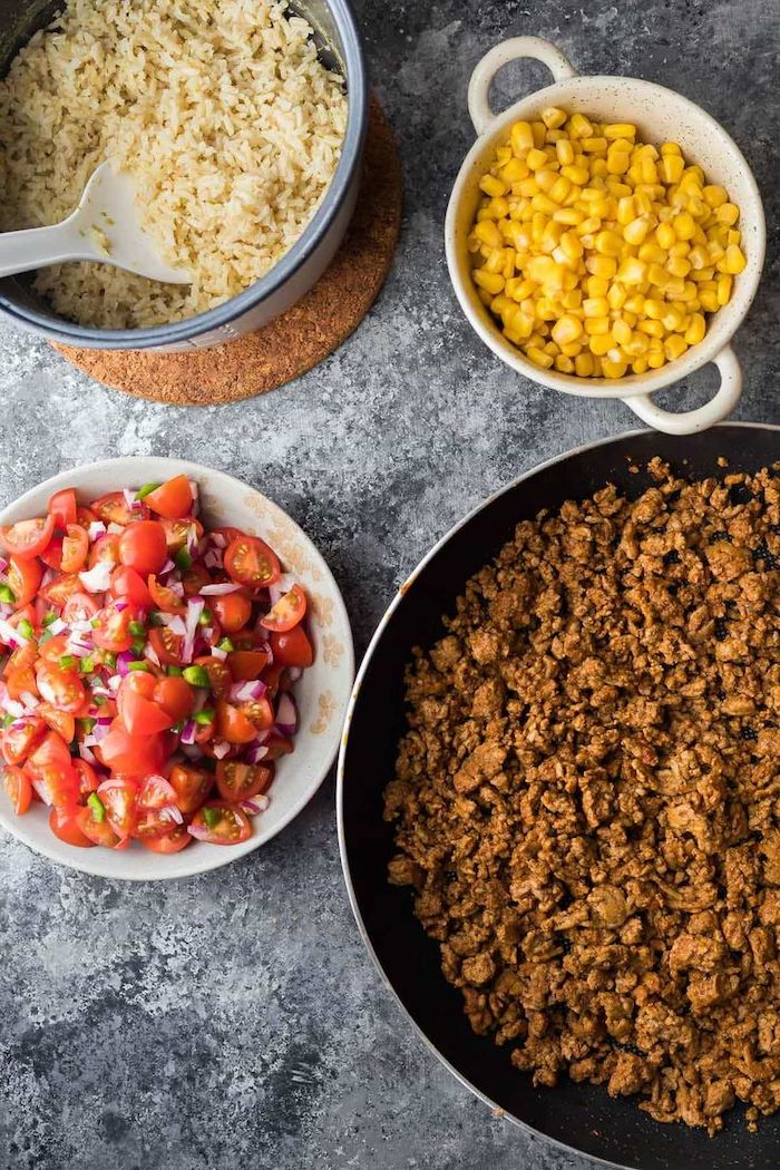 corn and salsa, in white bowls, ground turkey in a pan, boiled rice, chicken meal prep, granite countertop