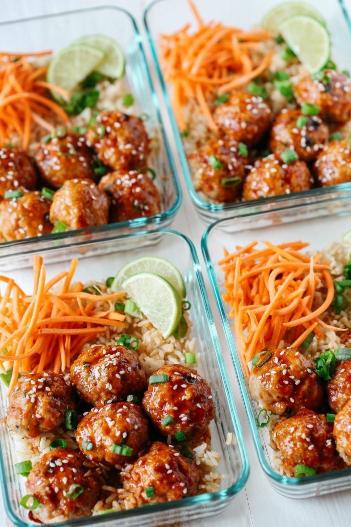 four glass containers, rice and carrots, honey sriracha meatballs, lime slices inside, healthy lunch recipes