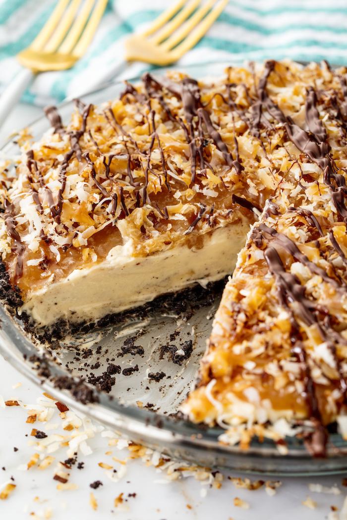 samoa pie, easy dessert recipes no baking, slice taken out, glass tray, white table