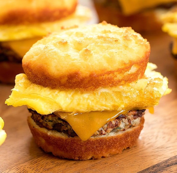 low carb breakfast without eggs, egg sandwich, with cheese and ground beef, wooden table