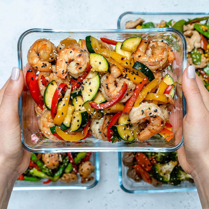 shrimp stir fry, inside a glass container, with sesame seeds, meal prep recipes chicken