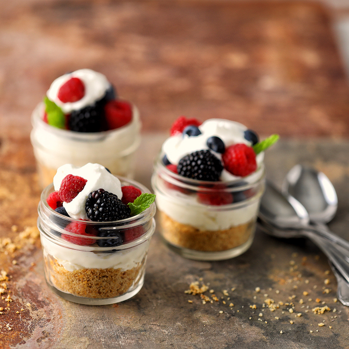cheesecake in small jars, blackberries and raspberries, blueberries on top, easy dessert recipes no baking