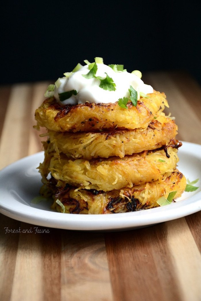spaghetti squash, low carb breakfast ideas, stacked together, sour cream, parsley on top, white plate