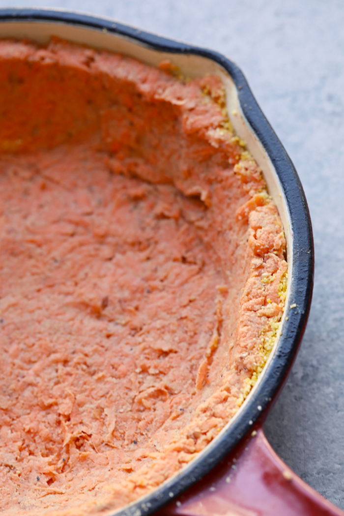 sweet potato crust, at the bottom, of a red skillet, granite countertop, meal prep recipes