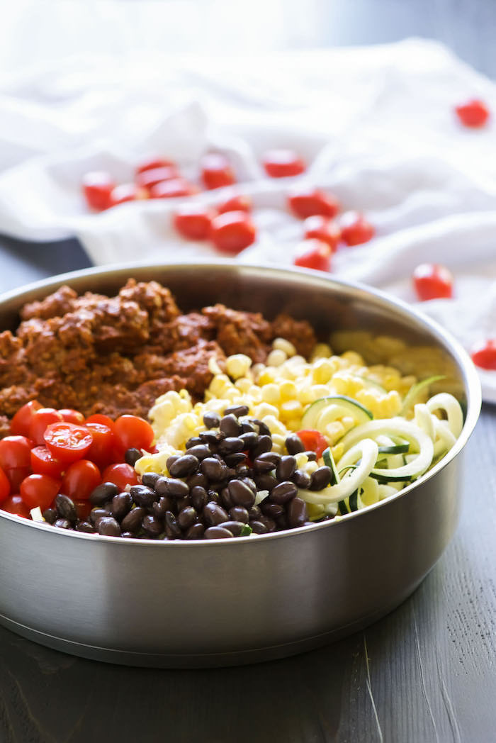 ground turkey, cherry tomatoes, black beans, corn and zoodles, in a skillet, how to make zucchini noodles