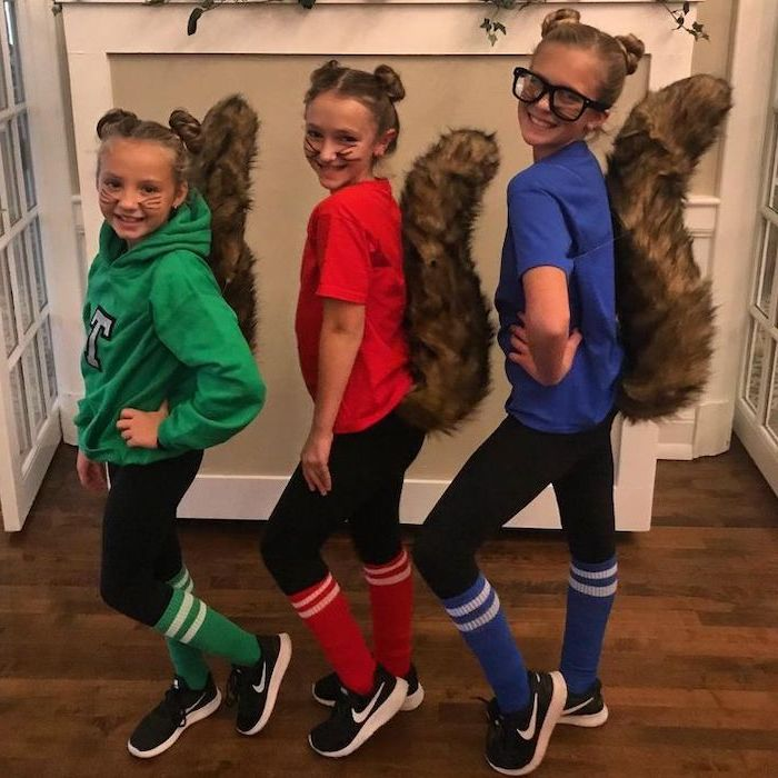 three girls, dressed as characters, from alvin and the chipmunks, twin halloween costumes, green red blue shirts