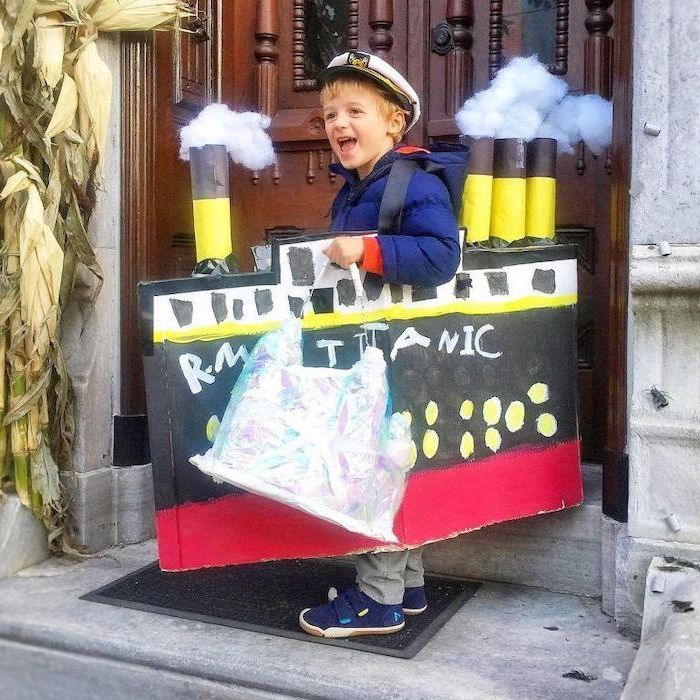titanic ship, made of carton, boy dressed as the captain, childrens halloween costumes, large wooden door