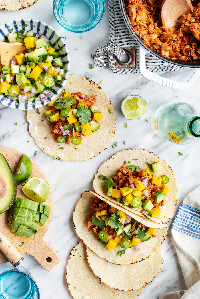 tortilla wraps, filled with vegetables, best taco seasoning, avocado slices, lime slices, marble countertop