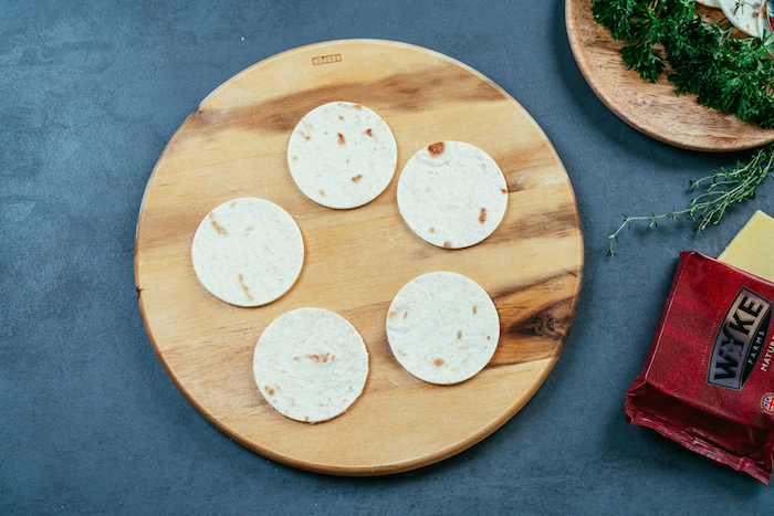 tortilla wraps, on a wooden, cutting board, how to make tacos, blue table, packet of cheese