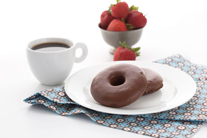 chocolate donuts, on white plate, keto breakfast ideas, coffee mug, strawberries in a metal bowl