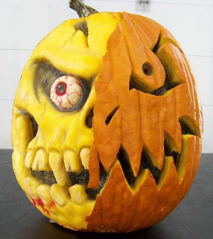 two faced pumpkin, one side without skin, scary face, carved into it, easy pumpkin carving ideas, white background