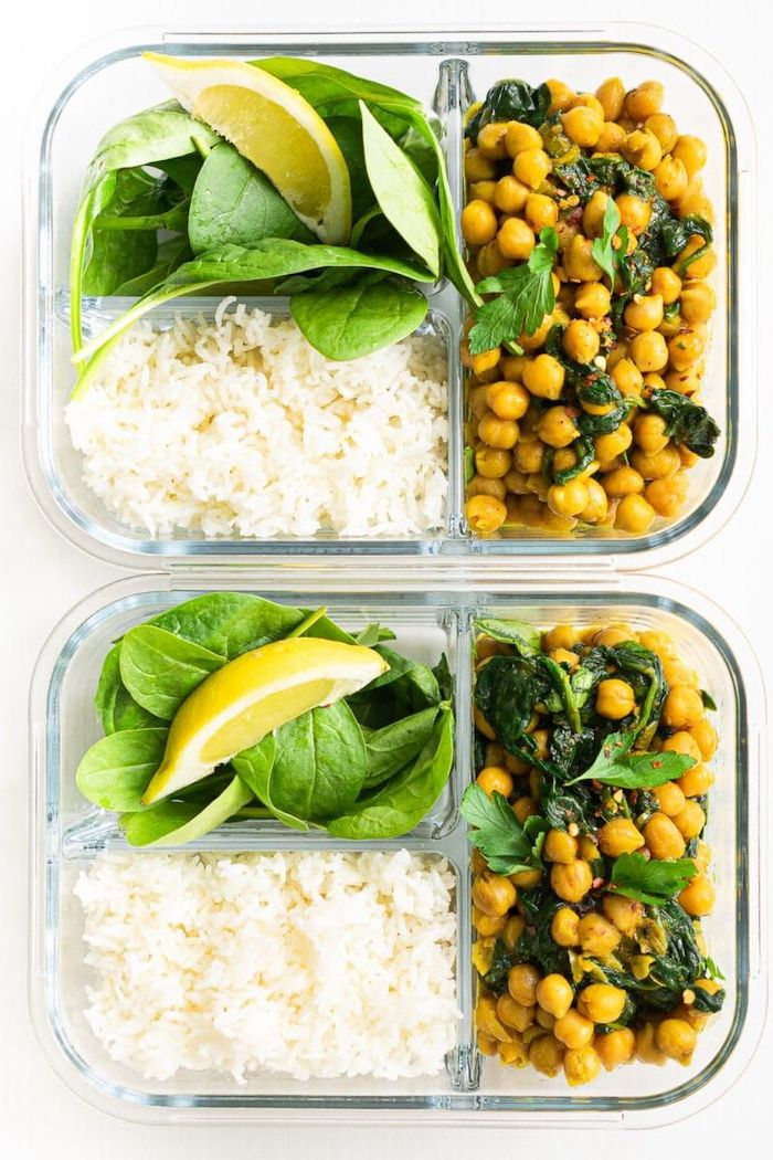 rice and spinach, meal prep for weight loss, chickpeas with parsley, lemon slice, in a glass container