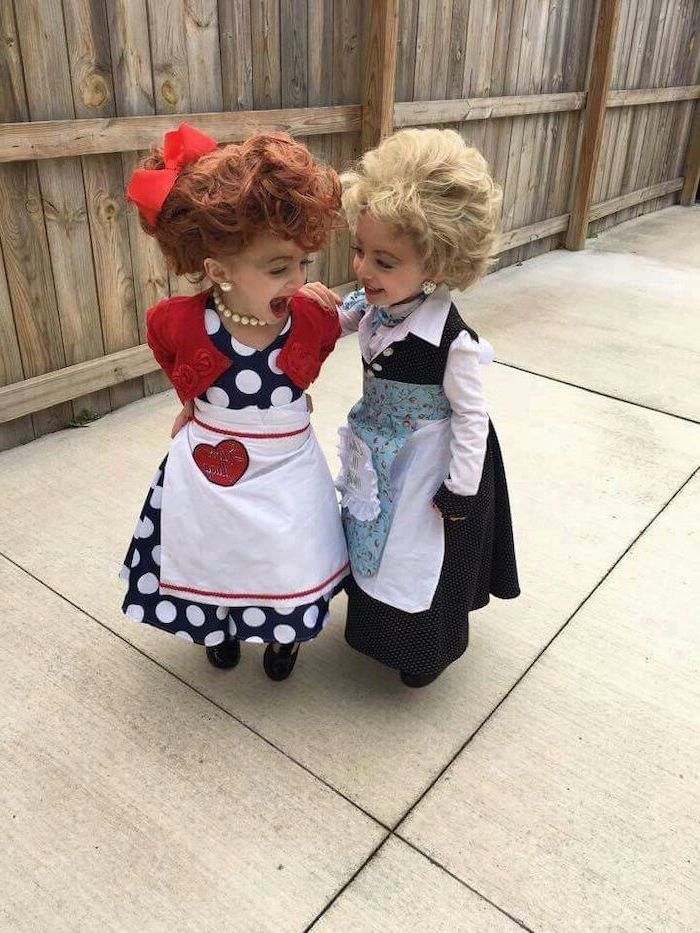 two girls, dressed as characters from i love lucy, funny halloween costumes for kids, pearl necklace, alrge wigs