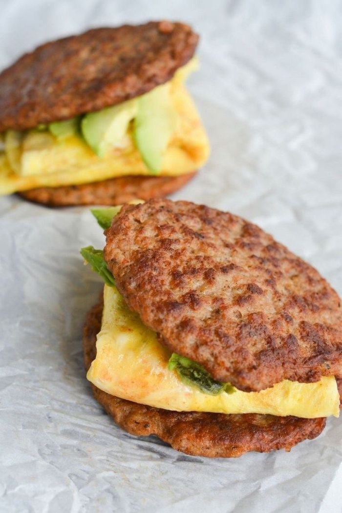 low carb breakfast ideas, ground beef sandwich, ham and cheese omelet inside, guacamole sauce