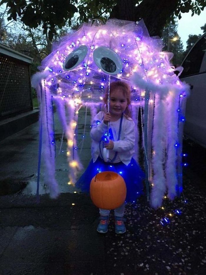 little girl, holding an umbrella, with white feathers, fairy lights, funny halloween costumes for kids, jellyfish costume