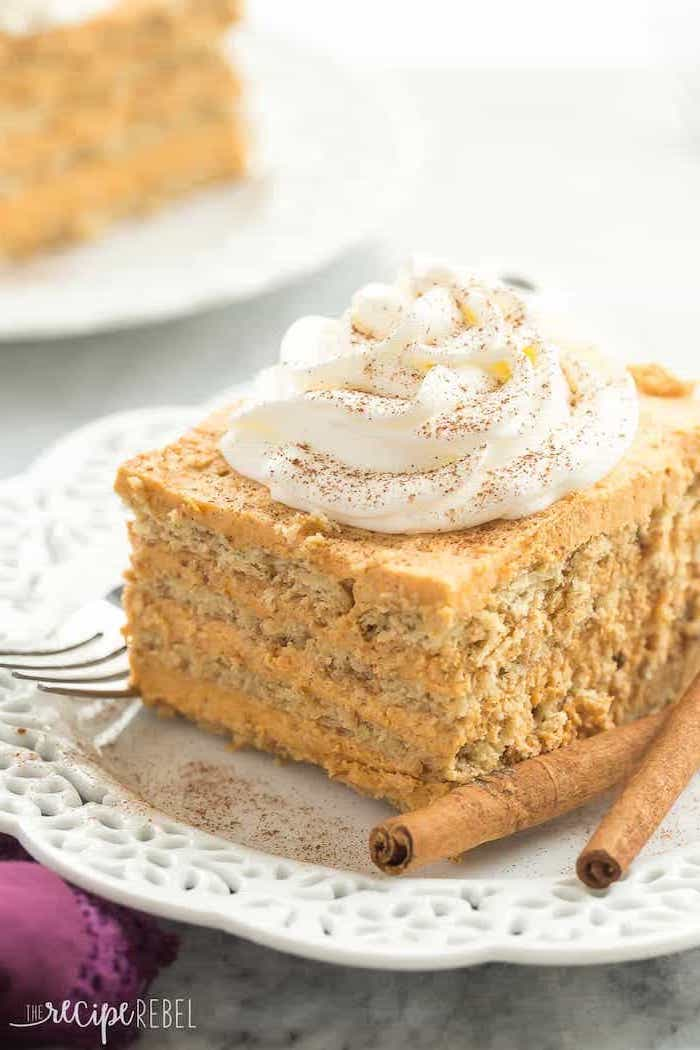 pumpkin pie, easy dessert recipes with pictures, covered in cinnamon, cinnamon sticks, on a white plate