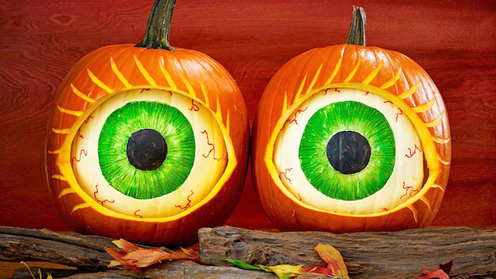 white pumpkins, eyes drawn on them, inside larger pumpkins, how to carve a pumpkin, wooden logs