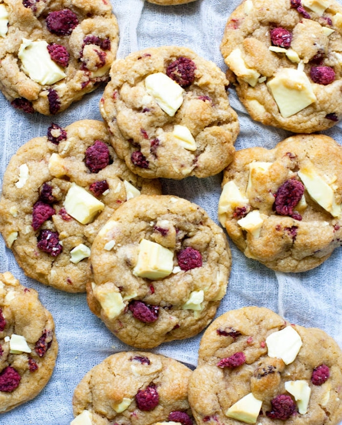 white chocolate chips, dried raspberries, homemade chocolate chip cookie recipe, white cloth underneath