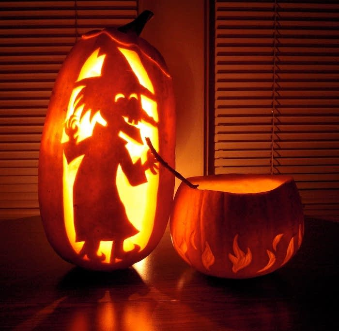 witch carved into a pumpkin, mixing a potion in another pumpkin, lit by candles, how to carve a pumpkin, easy pumpkin carving patterns