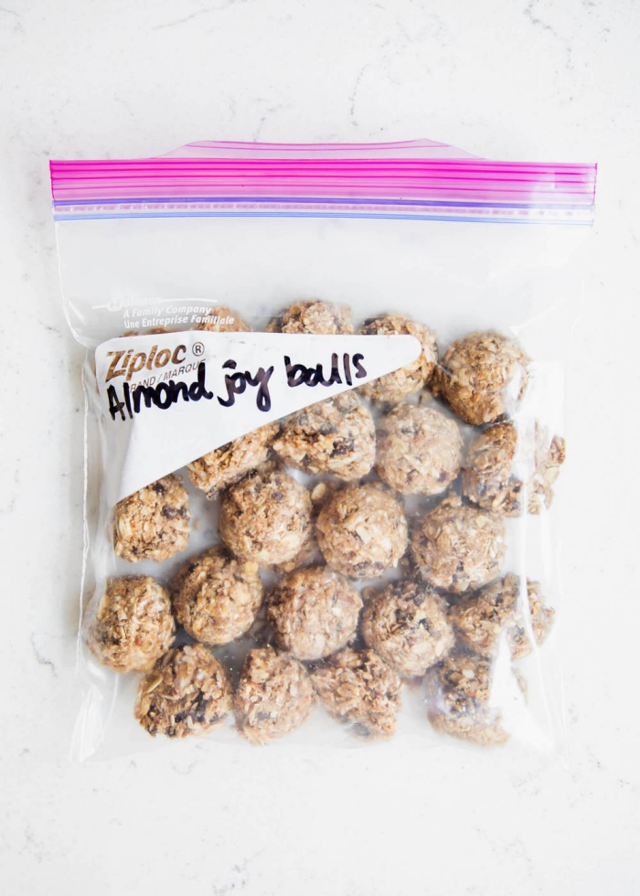 almond joy balls, peanut butter energy balls, in a ziploc bag, marble countertop