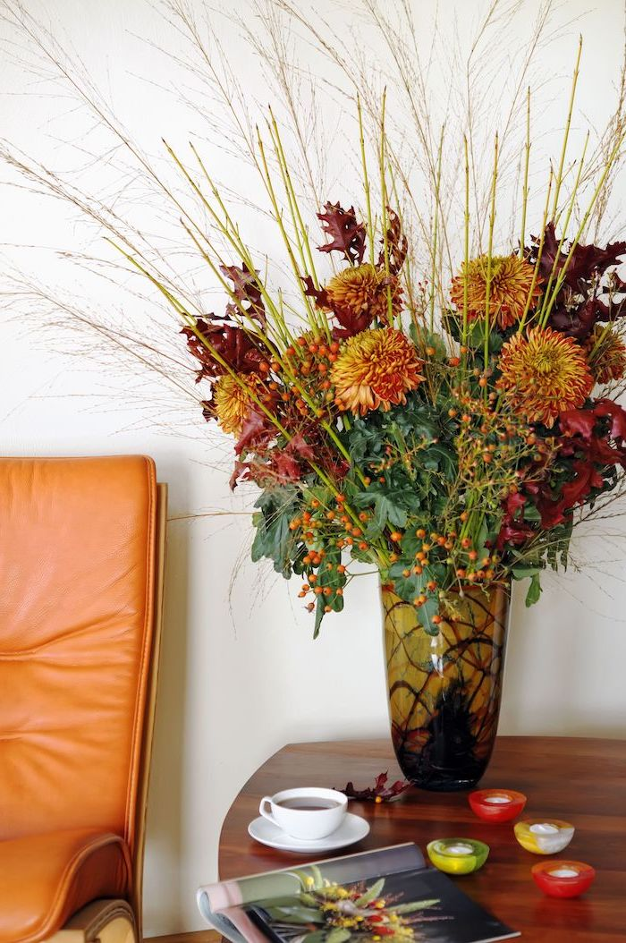 autumn flowers, large bouquet, thanksgiving decorations, wooden table, orange leather armchair