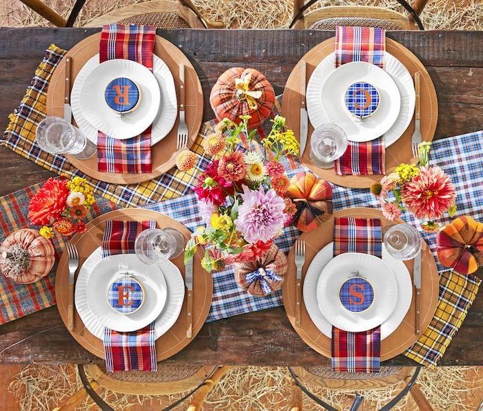 plate settings, on wooden table, flower bouquets, flannel table cloths, thanksgiving decorations