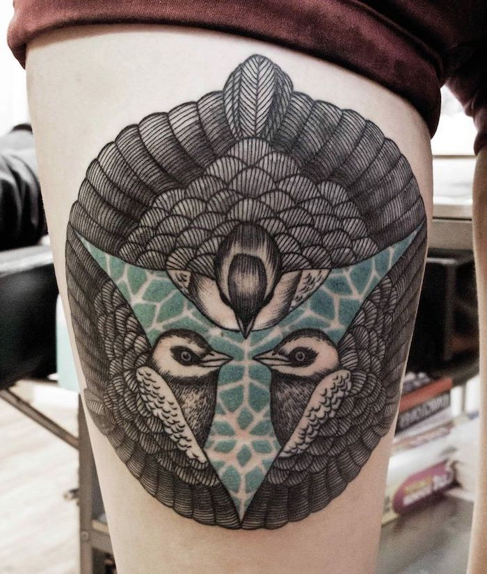 flower thigh tattoo, black and blue birds, geometrical tattoo, red velvet shorts