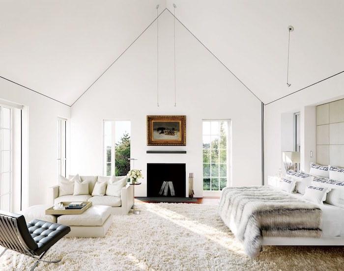 white aesthetic, white carpet, black leather armchair, white sofa, white ottomans, cathedral ceiling