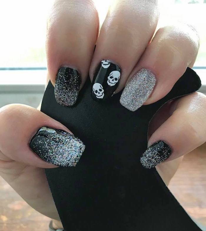 silver glitter, black nail polish, popular nail colors, white skulls, nail decorations, squoval nails