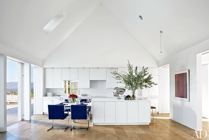 blue velvet chairs, tiled floor, white aesthetic, vaulted ceiling beams, white cupboards, kitchen island