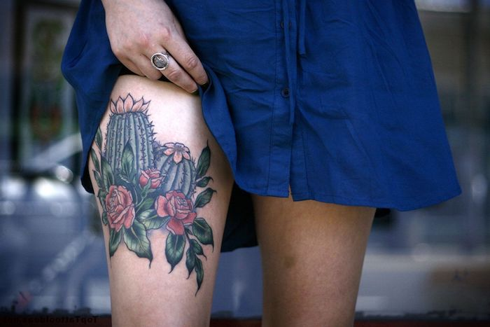 blue dress, cactuses and flowers, red roses, blurred background, thigh tattoos for women
