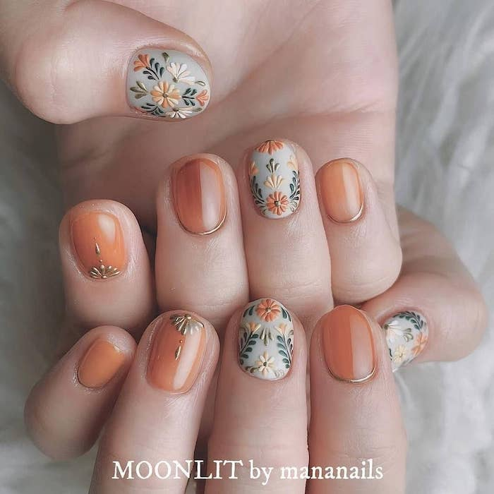 orange and grey nail polish, fall nail designs, floral designs, short squoval nails, white background
