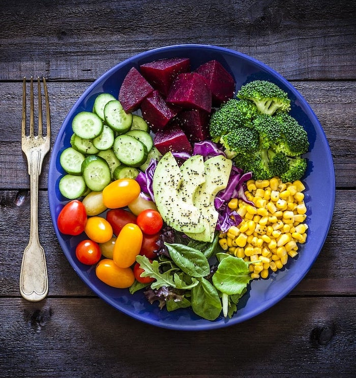 blue bowl, filled with vegetables, healthy meal plans, beets and broccoli, corn and spinach, avocado and tomatoes