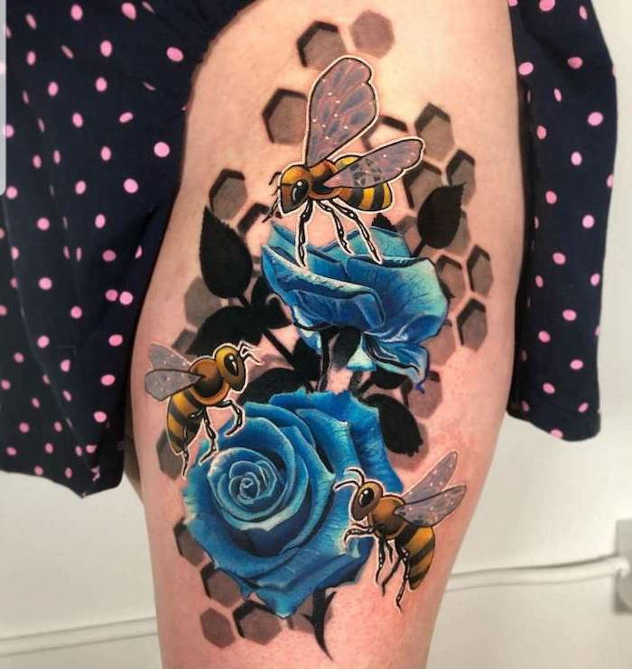 colored tattoo, blue roses, three bees, honeycomb shapes, thigh tattoos, black dress, with pink dots
