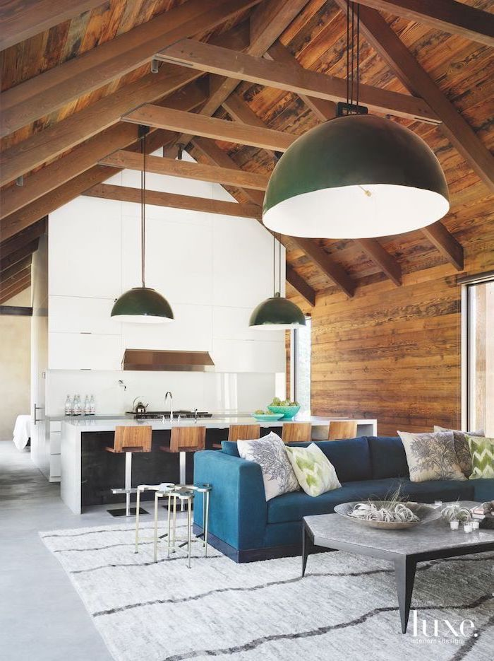blue velvet sofa, green and grey, throw pillows, vault definition, wooden ceiling, kitchen island, wooden stools