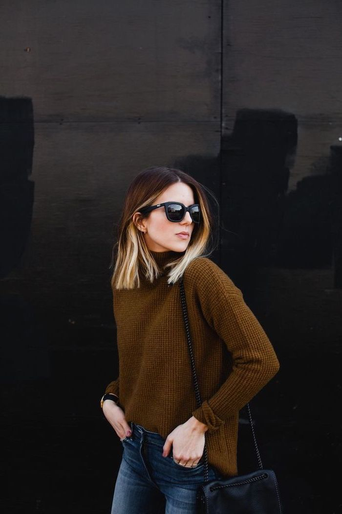 woman with balayage blonde hair, wearing brown sweater and jeans, sunglasses and bag, medium length hairstyles for women
