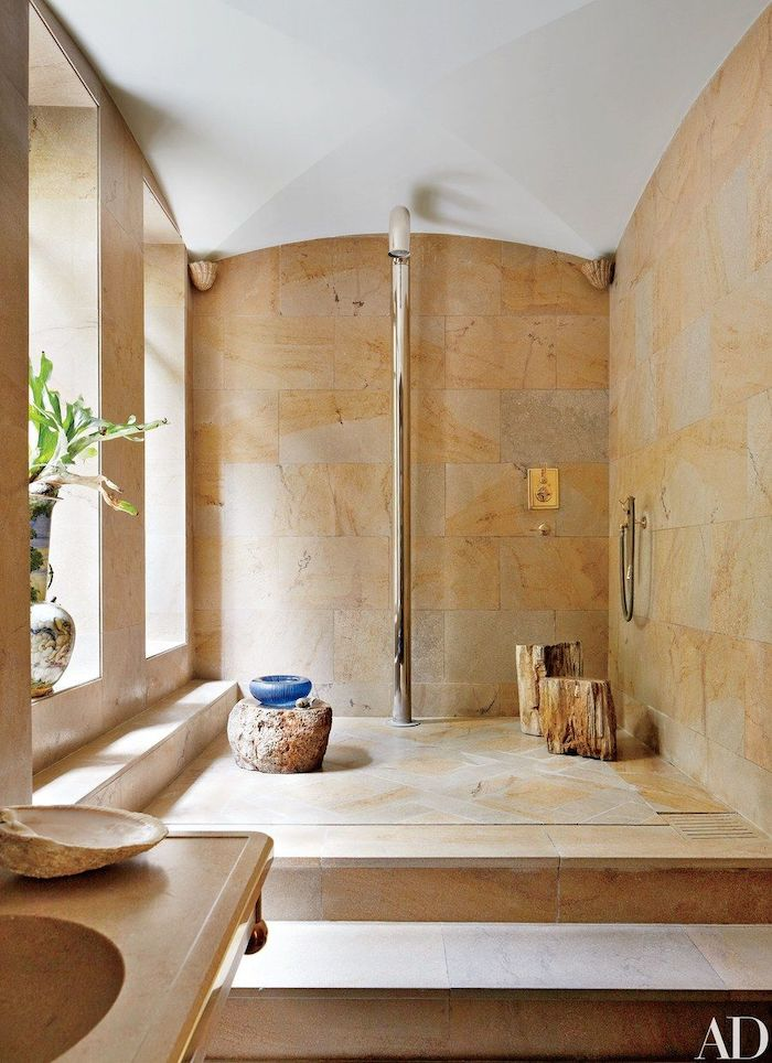 brown granite, tiled walls, cathedral ceiling, half barrel ceiling in white, wooden logs, shower head