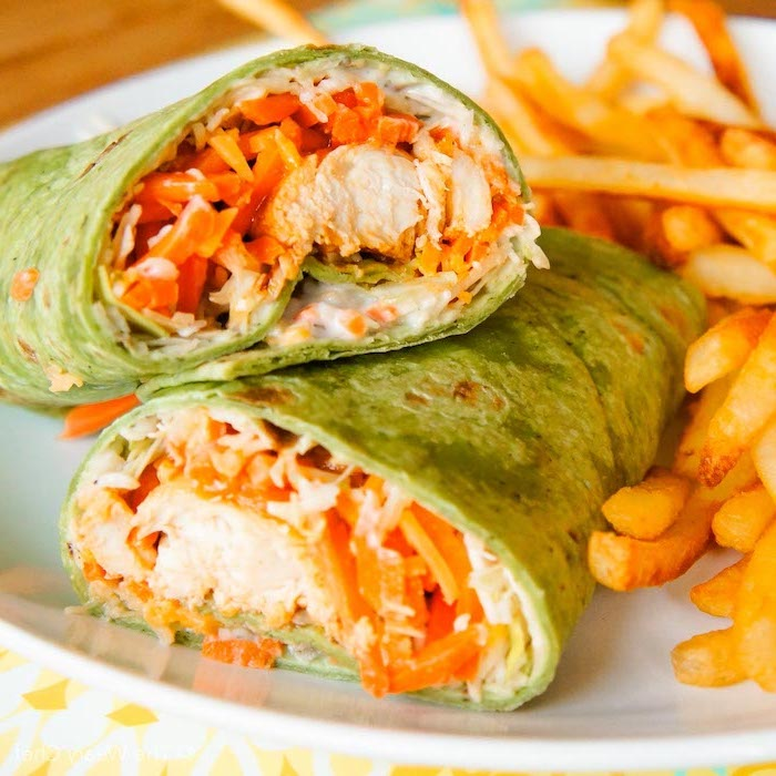 buffalo chicken wraps, french fries on the side, sour cream in side, easy dinner recipes for two, white plate