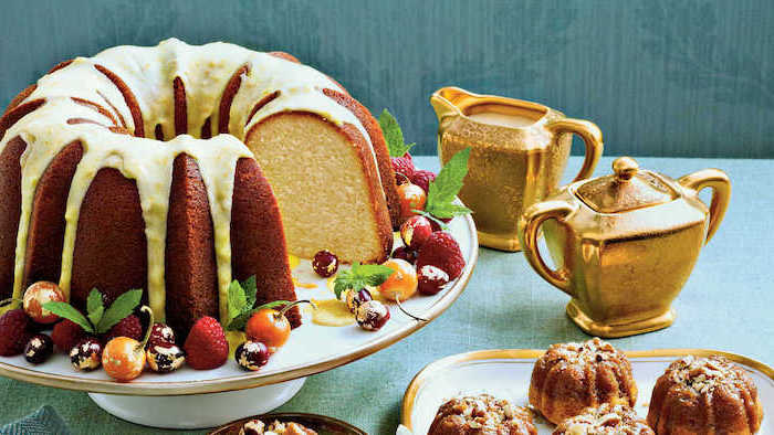 bundt cake, white frosting, on top, cute thanksgiving desserts, raspberries and cherries, cranberries on the side