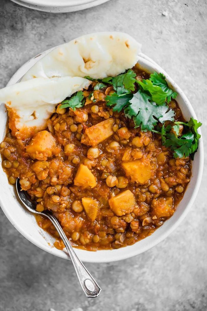 butternut squash, lentil stew, healthy recipes for weight loss, pita on the side, parsley garnish, white bowl