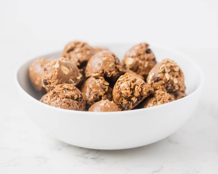 oatmeal bites, no bake energy bites, with peanut butter, chocolate chips, in white bowl