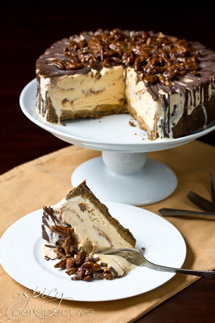 slice of cake, ice cream cake, best thanksgiving desserts, chocolate and walnuts on top, white cake stand, white plate