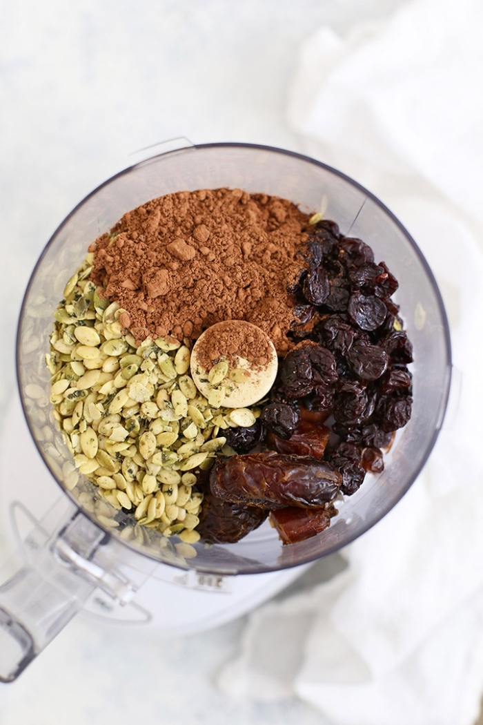 pistachio nuts, cocoa and dates, in a blender, energy bites, white background